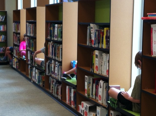 Students reading in windows of library